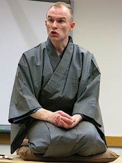 Performing the rakugo story Tachigire senkō (The Time Is Up Incense)